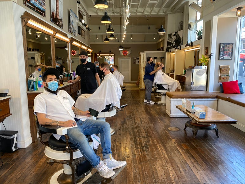 Lead Barber, Juan Sosa, at People's Barber on Polk Street, San Francisco. June 16, 2021.