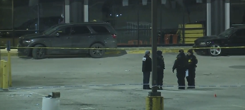 Police officers stand outside in bitter cold at the site of a deadly shooting outside the 9ine Ultra Lounge in the Kansas City area.