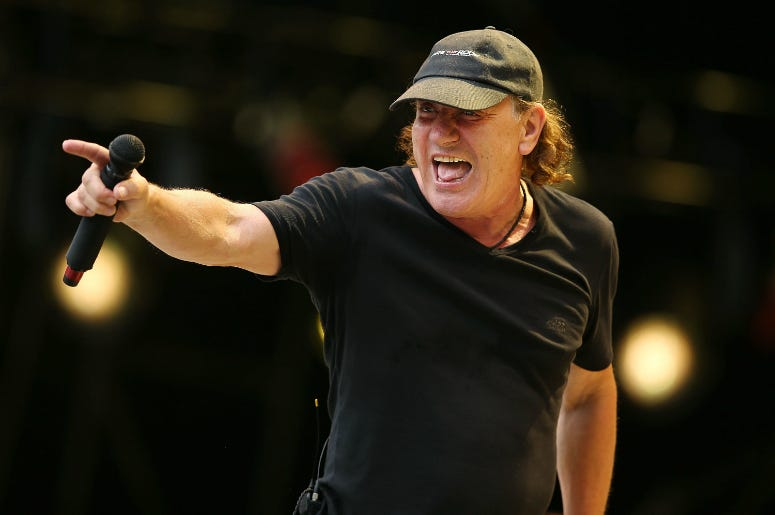 Brian Johnson of AC/DC performs on stage during a media call ahead of their 'Rock or Bust' world tour