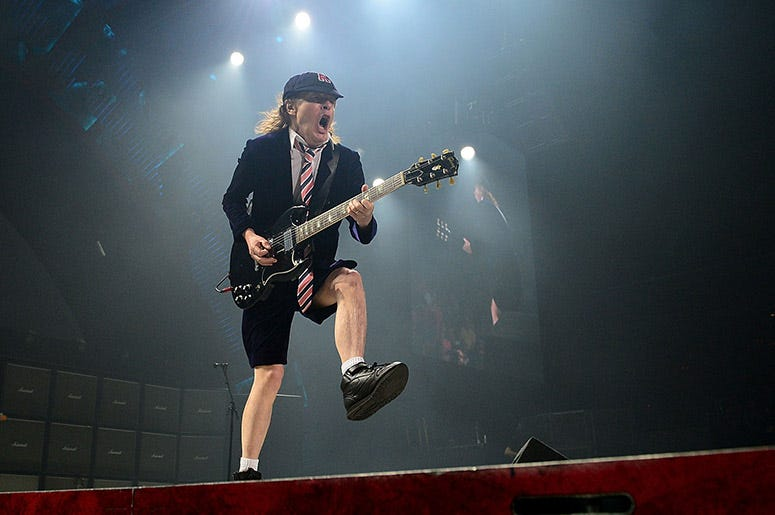 Angus Young performs with AC/DC