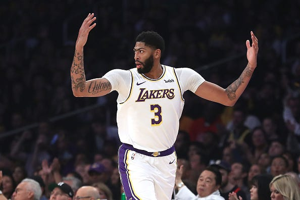 Anthony Davis celebrates draining a jumper for the Lakers.