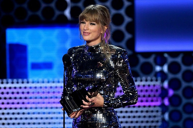 Taylor Swift accepts Favorite Album - Pop/Rock for 'Reputation' onstage during the 2018 American Music Awards