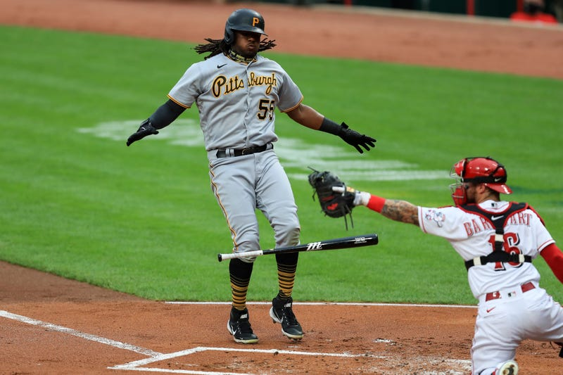 Pittsburgh Pirates' Josh Bell (55) reacts to drawing a walk