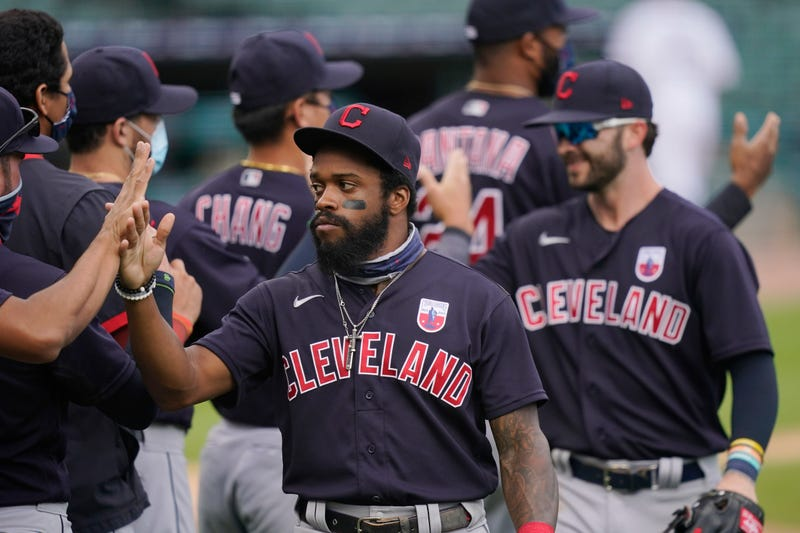 Cleveland Indians center fielder Delino DeShields greets teammates after their 8-5 over the Detroit Tigers in a baseball game, Sunday, Aug. 16, 2020, in Detroit