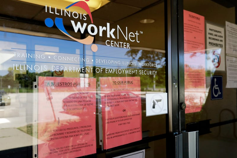 In this June 11, 2020, file photo, information signs are displayed at the closed Illinois Department of Employment Security WorkNet center in Arlington Heights, Ill.