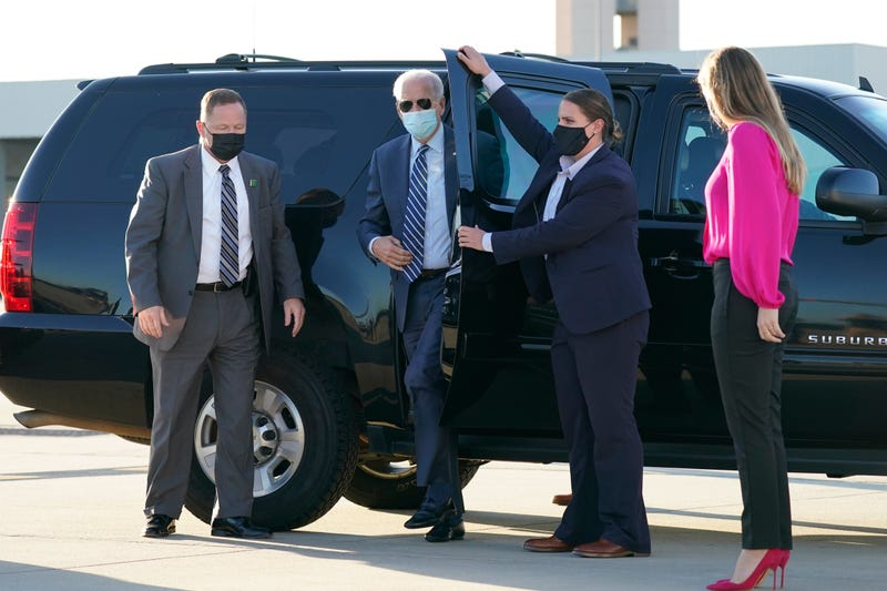 In this Oct. 18, 2020, photo, Democratic presidential candidate former Vice President Joe Biden steps out to board his campaign plane at Raleigh-Durham International Airport in Morrisville, N.C., en route to Wilmington, Del.