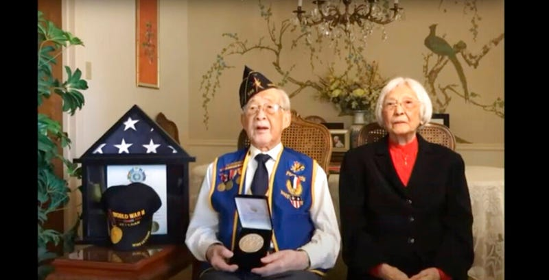 In this image from House Television video, Staff Sgt. Lewis Woo Yee of Houston, accepts a Congressional Gold Medal