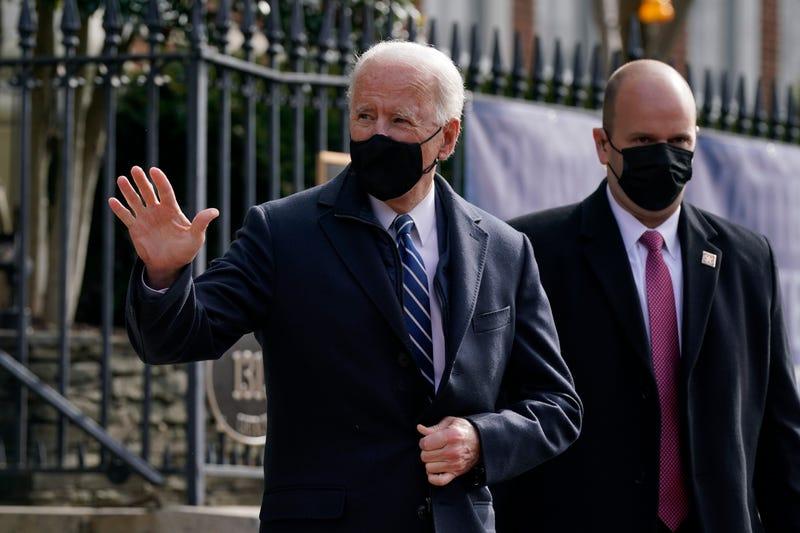 President Joe Biden waves as he departs after attending Mass at Holy Trinity Catholic Church, Sunday, Jan. 24, 2021, in the Georgetown neighborhood of Washington.