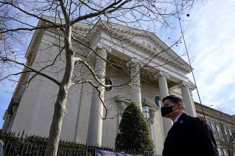 A member of the U.S. Secret Service stands guard outside Holy Trinity Catholic Church as President Joe Biden attends mass, Sunday, Jan. 24, 2021, in the Georgetown neighborhood of Washington.
