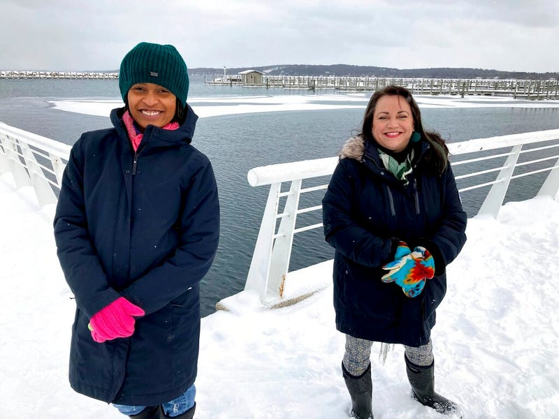 Activists Tyasha Harrison, left, and Holly T. Bird pose along the Grand Traverse Bay waterfront in Traverse City, Mich., Feb. 13, 2021.