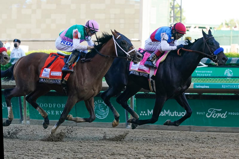 John Velazquez, right, rides Medina Spirit ahead of Florent Geroux aboard Mandaloun to win the 147th running of the Kentucky Derby at Churchill Downs, Saturday, May 1, 2021, in Louisville, Ky