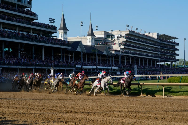 Medina Spirit, right, with John Velazquez aboard, leads the field around the first turn on the way to winning the 147th running of the Kentucky Derby at Churchill Downs, Saturday, May 1, 2021, in Louisville, Ky