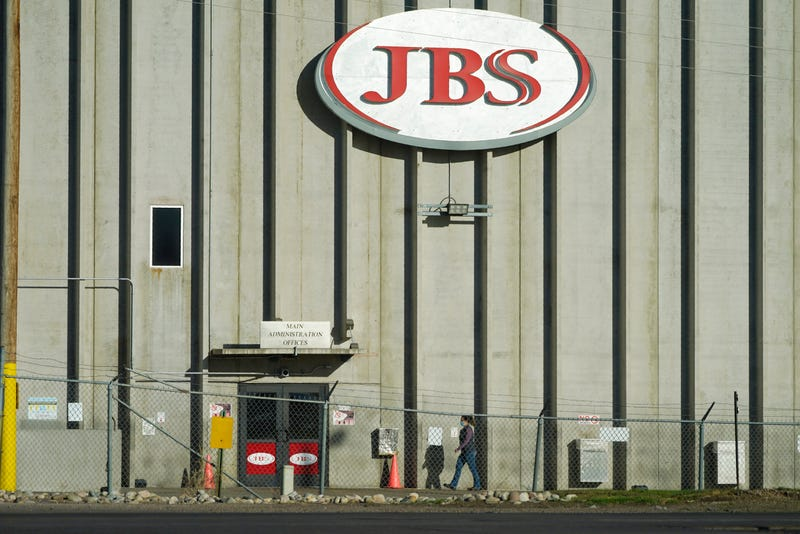 A worker heads into the JBS meatpacking plant in Greeley, Colo.