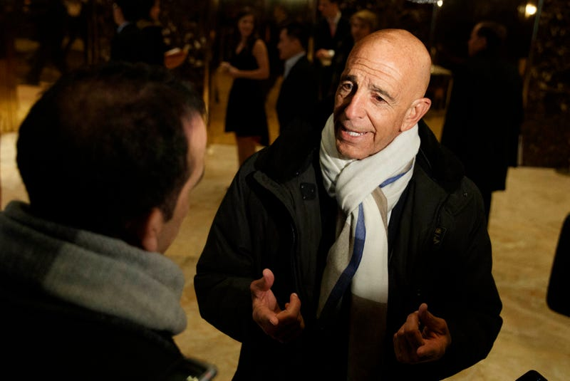 FILE - This photo from Tuesday Jan. 10, 2017, shows Tom Barrack peaking with reporters in the lobby of Trump Tower in New York before meeting with President-elect Donald Trump. Barrack, chair of former President Donald Trump's 2017 inaugural committee, was arrested Tuesday, July 20, 2021, in California on charges alleging that he and others conspired to influence Trump's foreign policy positions to benefit the United Arab Emirates. (AP Photo/Evan Vucci, File)