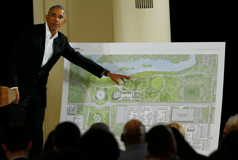 FILE - In this May 3, 2017, file photo, former President Barack Obama points to a rendering for the former president's lakefront presidential center at a community event at the South Shore Cultural Center in Chicago. Obama's presidential center will move another step closer to its brick-and-mortar future Tuesday, Sept. 28, 2021 when ground is broken.