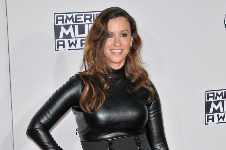 Alanis Morissette arrives at the 2015 American Music Awards