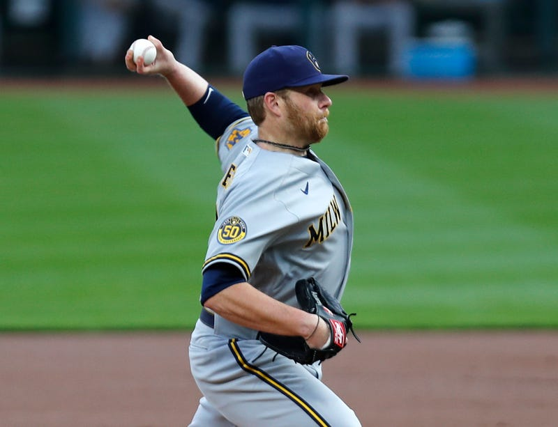 Sep 22, 2020; Cincinnati, Ohio, USA; Milwaukee Brewers starting pitcher Brett Anderson (25) throws against the Cincinnati Reds during the first inning at Great American Ball Park. Mandatory Credit: David Kohl-USA TODAY Sports