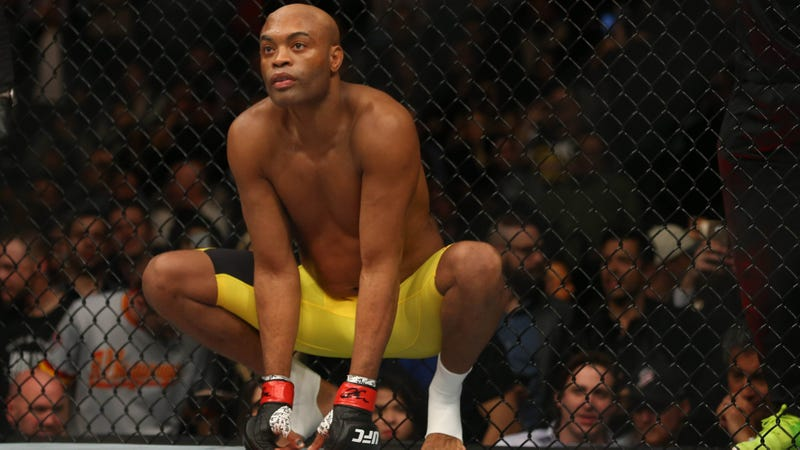 Anderson Silva crouches in cage