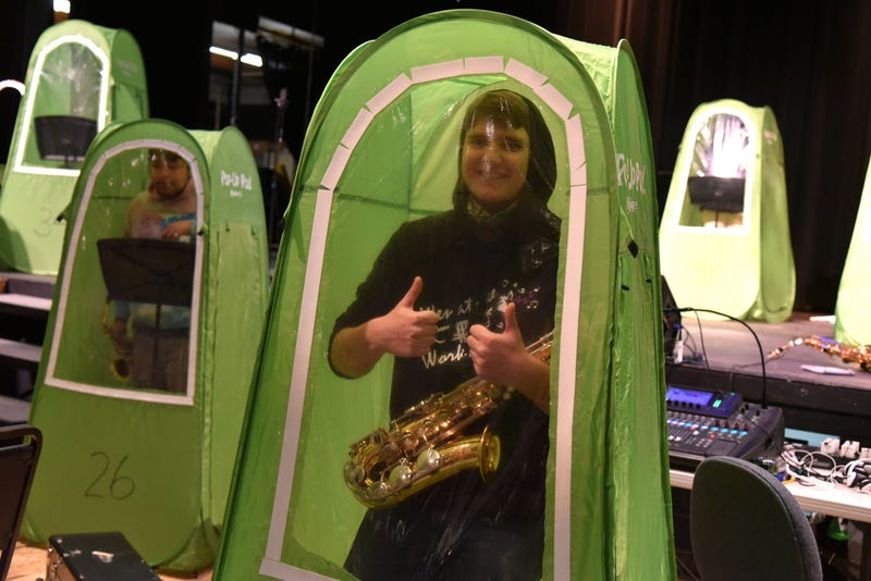 "The Wenatchee High School band plays in so-called ""pop-up music pods,"" a safe way for the students to practice indoors."