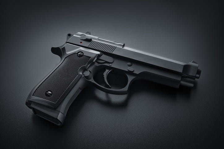 Black handgun on black background