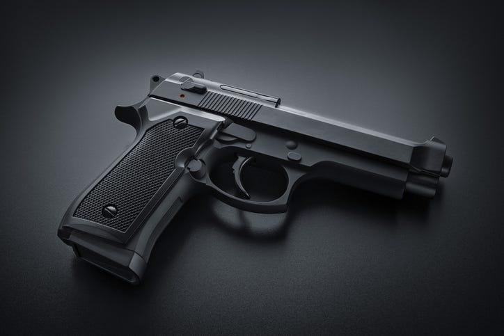 Black gun on black background