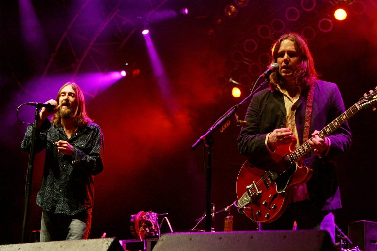 Chris Robinson (L), and his brother, guitarist Rich Robinson of The Black Crowes, perform at the Vegoose music festival