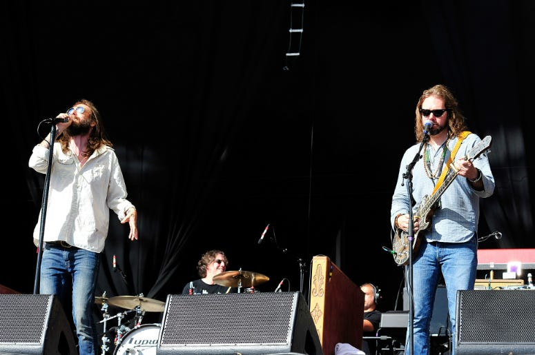 Chris Robinson (L) and Rich Robinson of the Black Crowes perform at Hard Rock Calling Day
