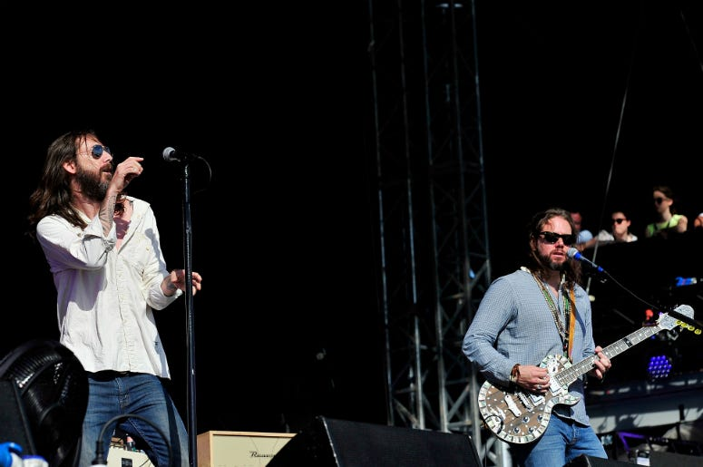 Chris Robinson (L) and Rich Robinson of the Black Crowes perform at Hard Rock Calling in 2013