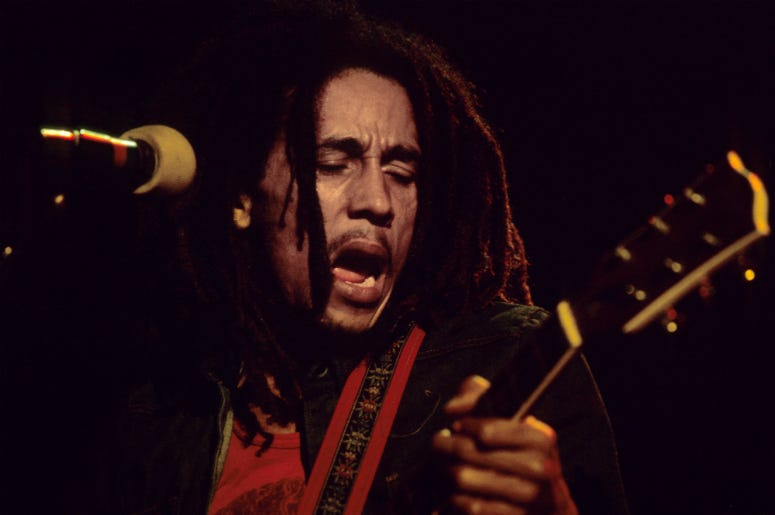 Bob Marley plays his guitar on stage during a gig at the Hammersmith Odeon, London