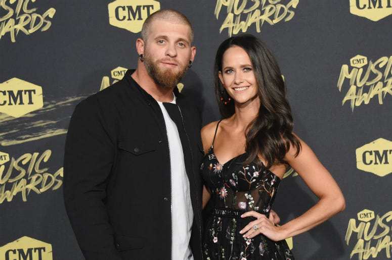 Brantley Gilbert (L) and Amber Cochran attend the 2018 CMT Music Awards at Bridgestone Arena