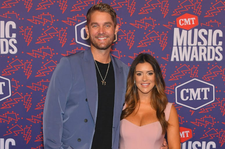 Brett Young and Taylor Mills attend the 2019 CMT Music Awards