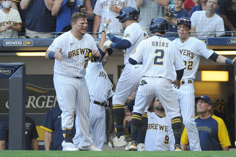Jun 13, 2021; Milwaukee, Wisconsin, USA; Milwaukee Brewers first baseman Daniel Vogelbach (20) and center fielder Avisail Garcia (24) and third baseman Luis Urias (2) and left fielder Christian Yelich (22) celebrate center fielder Avisail Garcia's (24) home run against the Pittsburgh Pirates in the sixth inning at American Family Field. Mandatory Credit: Michael McLoone-USA TODAY Sports