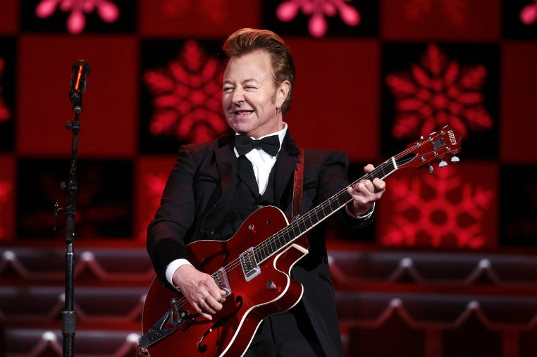Brian Setzer Orchestra performing at Christmastime.