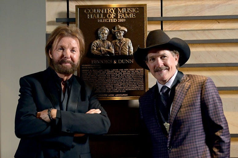 Inductee Ronnie Dunn and Kix Brooks of Brooks & Dunn seen with their Hall of Fame plaque