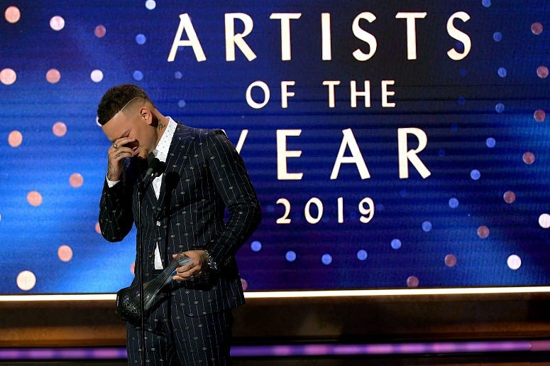 Kane Brown accepts an award onstage during the 2019 CMT Artists of the Year