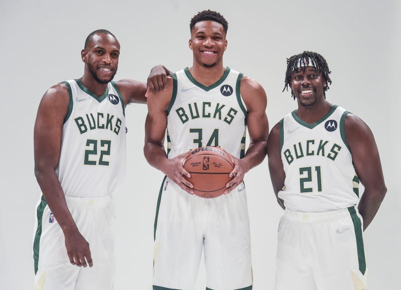 Sep 27, 2021; Milwaukee, WI, USA; Milwaukee Bucks forward Khris Middleton (22) and forward Giannis Antetokounmpo (34) and guard Jrue Holiday (21) pose for pictures during Media Day at the Fiserv Forum. Mandatory Credit: Benny Sieu-USA TODAY Sports