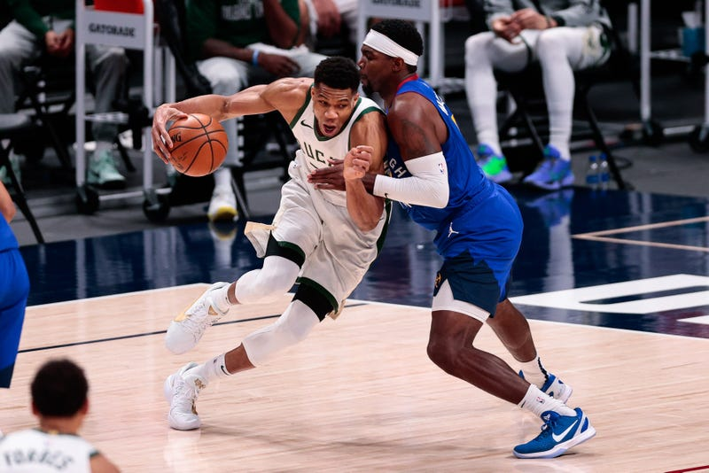 Feb 8, 2021; Denver, Colorado, USA; Milwaukee Bucks forward Giannis Antetokounmpo (34) controls the ball as Denver Nuggets forward Paul Millsap (4) guards in the fourth quarter at Ball Arena. Mandatory Credit: Isaiah J. Downing-USA TODAY Sports