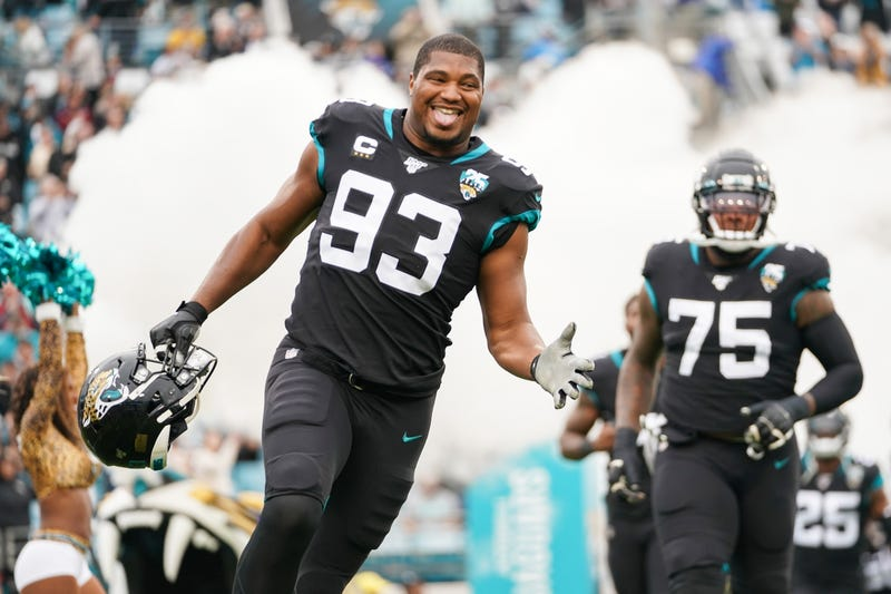 DE Calais Campbell runs out of the tunnel at a Jaguars home game.