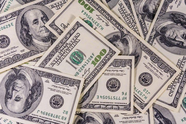 Hundred dollar bills in a pile