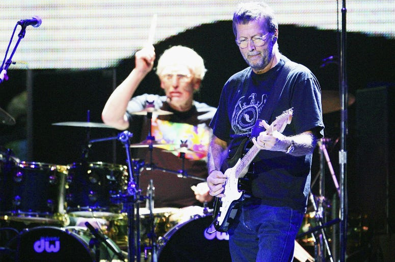 Eric Clapton (R) and Ginger Baker of Cream perform onstage at Madison Sqaure Garden October 25, 2005