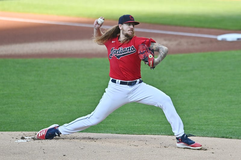 Caption: Aug 5, 2020; Cleveland, Ohio, USA; Cleveland Indians starting pitcher Mike Clevinger (52) throws a pitch during the first inning against the Cincinnati Reds at Progressive Field.