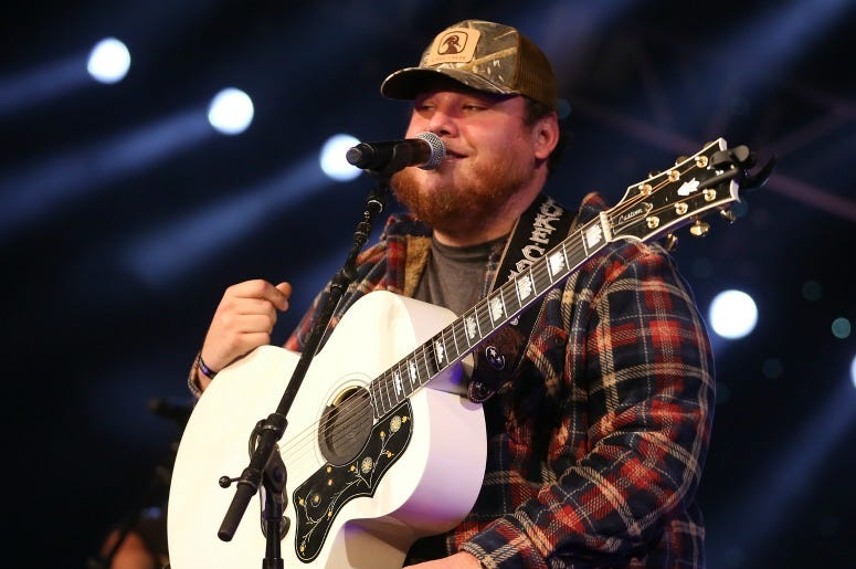 Luke Combs performs during a Radio.com 'Stars and Strings' Concert to honor our nation's veterans at Chicago Theatre on November 7, 2018