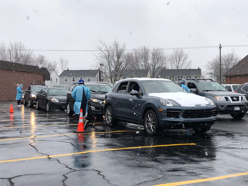 Cars line up outside Brighton Eggert Pharmacy to receive a rapid test. December 1, 2020
