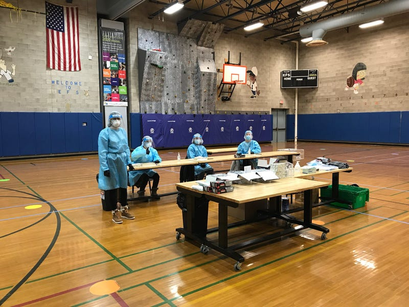 Health care workers from Brighton Eggert Pharmacy at Elmwood Franklin School.