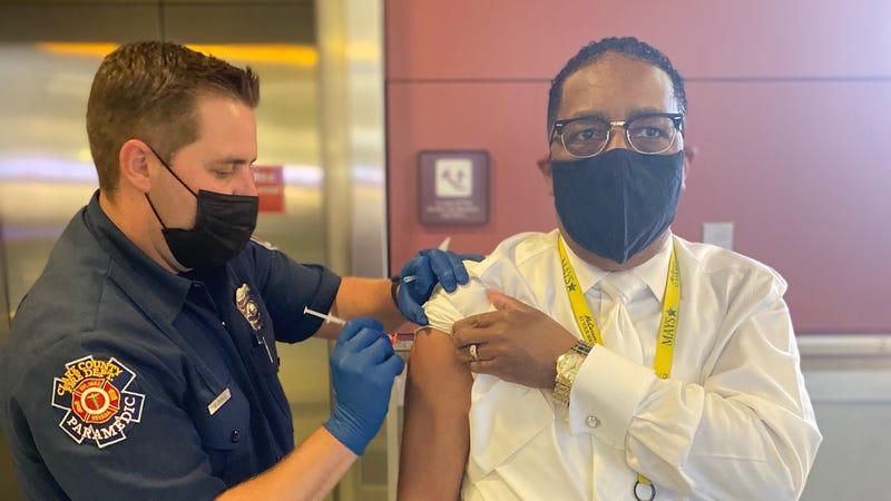 A man receives his coronavirus vaccination at McCarran International Airport in Las Vegas, NV.