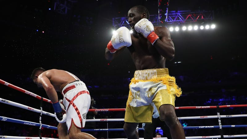 Terence Crawford hits Amir Khan with an accidental low blow during their welterweight boxing match at Madison Square Garden.