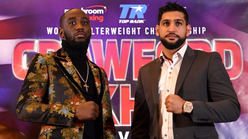 Terence Crawford and Amir Khan pose at a press conference to promote their April 20 welterweight boxing match.