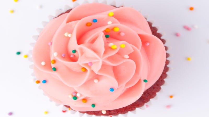 Pink sprinkle cupcake close-up Getty Images