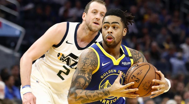 D'Angelo Russell of the Golden State Warriors drives on Joe Ingles of the Utah Jazz on Jan. 22, 2020, at Chase Center in San Francisco.