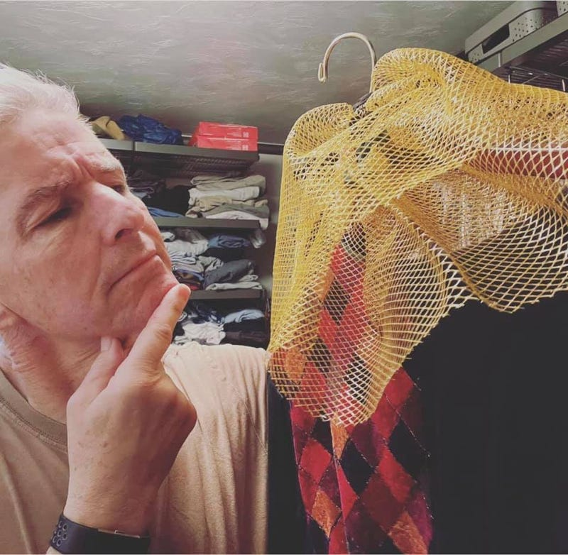 David in his closet with a jester costume